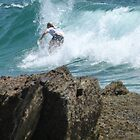 Surfer Near Rocks by FangFeatures