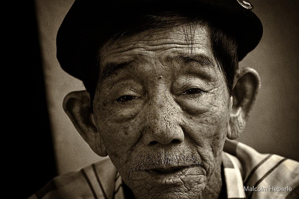 Vietnam - Ho Chi Minh City - Old Man Street Artist by Malcolm Heberle