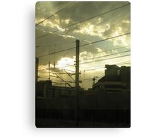 Sun rising over cityscape Canvas Print