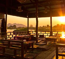 Chilling over the Mekong at Sunset by MichaelDarn
