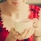 Female Hands Holding A Cup by GrishkaBruev
