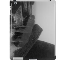 A Wave Crashing on Concrete Blocks at the Beach in the Fog iPad Case/Skin
