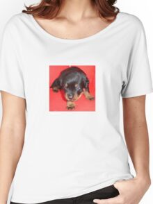Young Rottweiler Puppy On A Red Background Women's Relaxed Fit T-Shirt