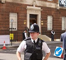 A police officer outside St Mary's Hospital London by Keith Larby