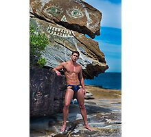 Man in speedos at beach with modern rock art Photographic Print