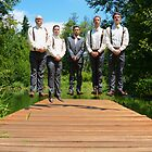 Groomsmen jump by Carl LaCasse