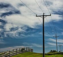 Power Lines and Poles along a Wooden Farm Fence by Randall Nyhof