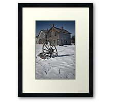 Wagon wheel in winter at the mining ghost town at Fayette Framed Print