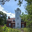 Forty Mile Point Lighthouse in Michigan by Randall Nyhof
