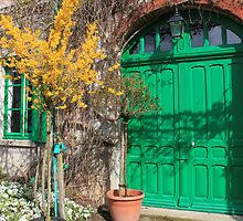 The front door to Monet's house in Giverny by Monica Batiste
