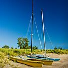 Catamaran Sailboats on a Beach by Randall Nyhof