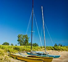 Catamaran Sailboats on a Beach by Randall Nyhof