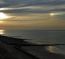 Cromers setting sun and Sundog by Avril Harris