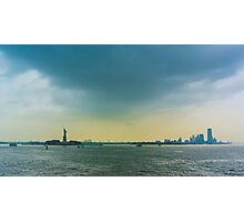 New York, the statue of liberty and Manhattan at sunset. Photographic Print