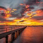 sun rise at the jetty by ketut suwitra