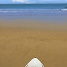golden beach with surfboard by morrbyte