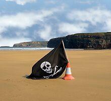 sandy beach with jolly roger flag by morrbyte