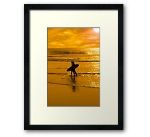 silhouette of surfing couple walking from the sea Framed Print
