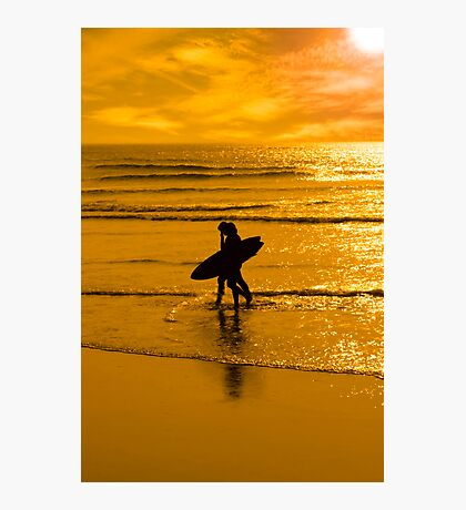 silhouette of surfing couple walking from the sea Photographic Print