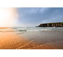 surfers near cliffs at sunset Photographic Print