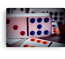 Domino game in play on family game night Canvas Print