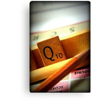 Scrabble board game being played on family game night Canvas Print