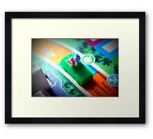 Life board game being played on family game night Framed Print