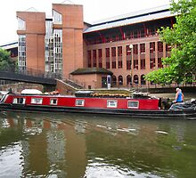 Canal boat in the city. by ronsaunders47