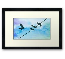 Doves on wire Framed Print