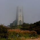 Ghostly Happisburgh church in a sea fret by Avril Harris