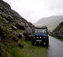 Landrover in Irish landscape of stormy mountains by Grace Johnson