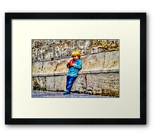 Blond Child Holding a Box in Valencia, Spain Framed Print