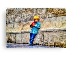Blond Child Holding a Box in Valencia, Spain Canvas Print