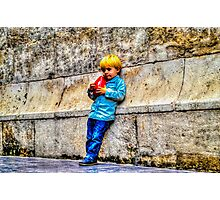 Blond Child Holding a Box in Valencia, Spain Photographic Print