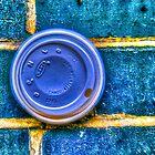 Cup Stuck in a Wall in London, UK by Noam  Kostucki
