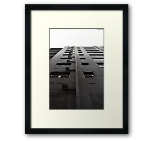 Scale tall buildings Framed Print