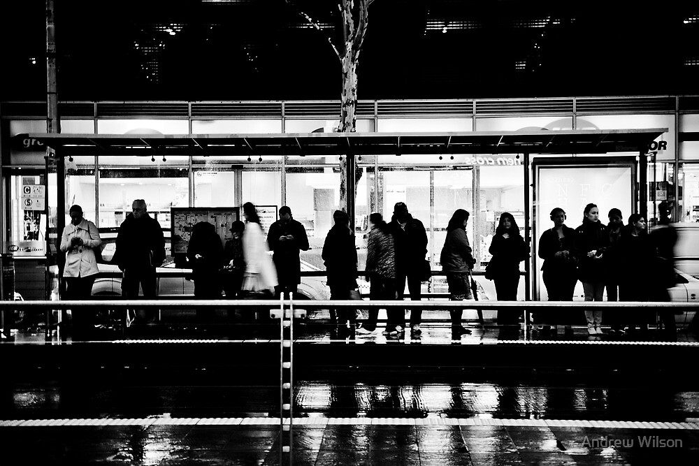 Shadows at the tram stop by Andrew Wilson