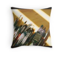 Art brushes on a wood table Throw Pillow