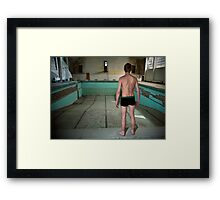 Young man in an empty abandoned swimming pool  Framed Print