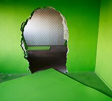 Hole in a green wall  by Reinvention