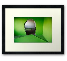 Hole in a green wall  Framed Print