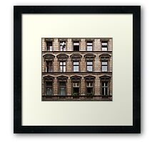 Facade of an old grey building in East Berlin Framed Print