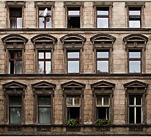 Facade of an old grey building in East Berlin Photographic Print