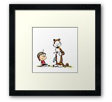 Calvin And Hobbes playing Framed Print