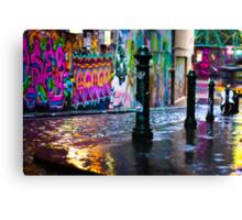 Bollards in a Rainy Graffiti Lane Canvas Print