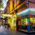 Espresso Bar Cafe on a City Street by jamjarphotos
