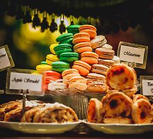 Macaroons piled up on a cake stand by jamjarphotos