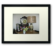 An Antique Clock and a Lamp Framed Print