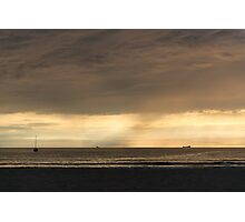 Storm clearing the beach Photographic Print