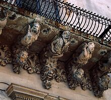 Balcony with people support brackets Noto Sicily 198403270033  by Fred Mitchell
